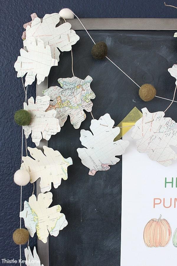 Map Leaf Garland Draped Over A Chalkboard