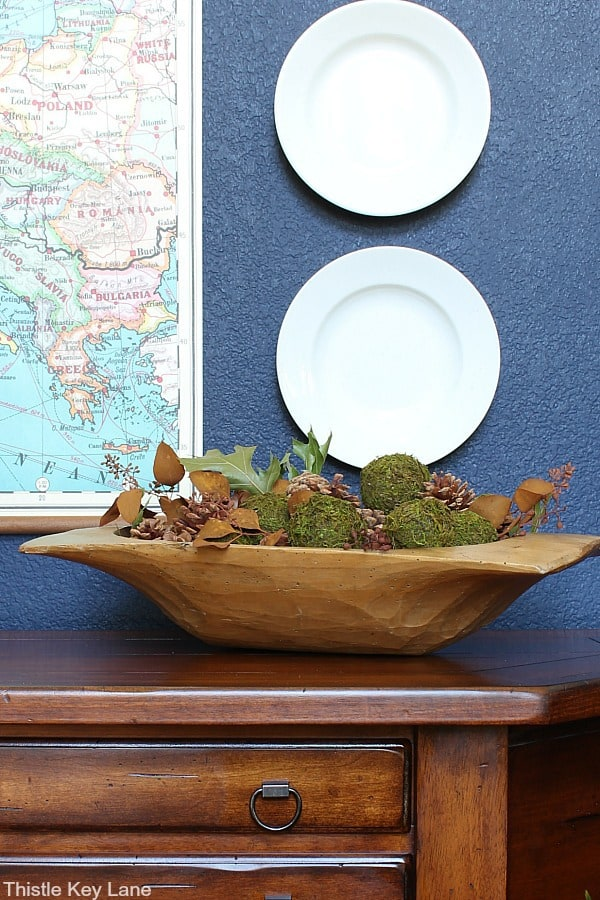 Dough bowl with pinecones and moss balls. Styling A Simple Fall Entry Table.