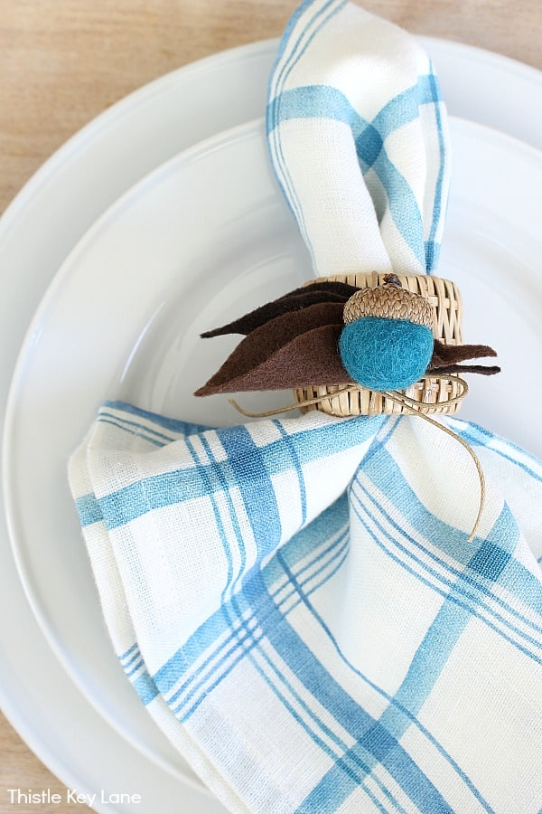 Bright blue and white plaid napkin with felt acorn napkin ring. DIY Felt Acorn Napkin Rings.