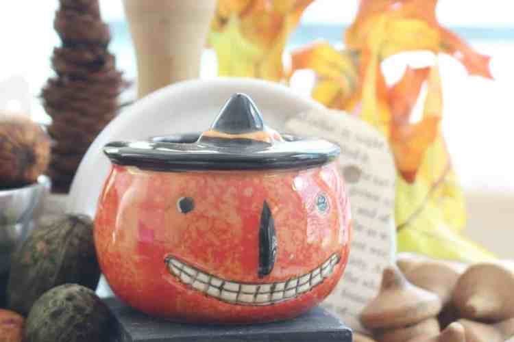 Pumpkin Face Candle With A Vintage Look.
