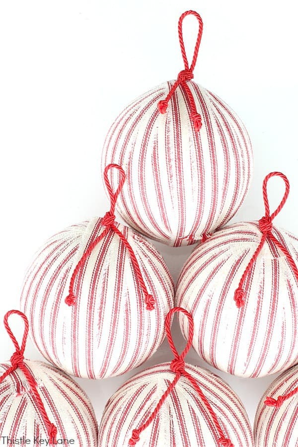 Red Ticking Ornaments with Red Cord Hangers.