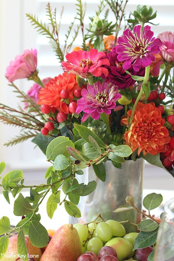 Colorful Arrangement Of Zinnias And Dahlias - Thanksgiving Fruit And Flower Tablescape.