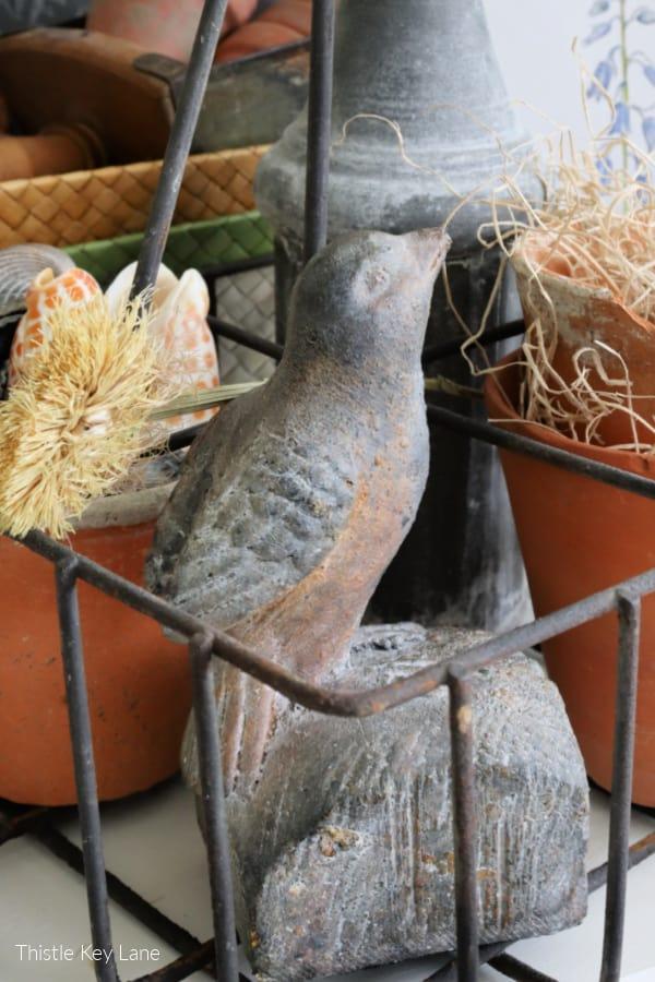 Vintage cast concrete bird.