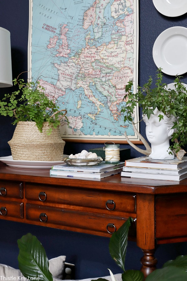 Entry table with map and plates on wall. Early Spring Entry Table.