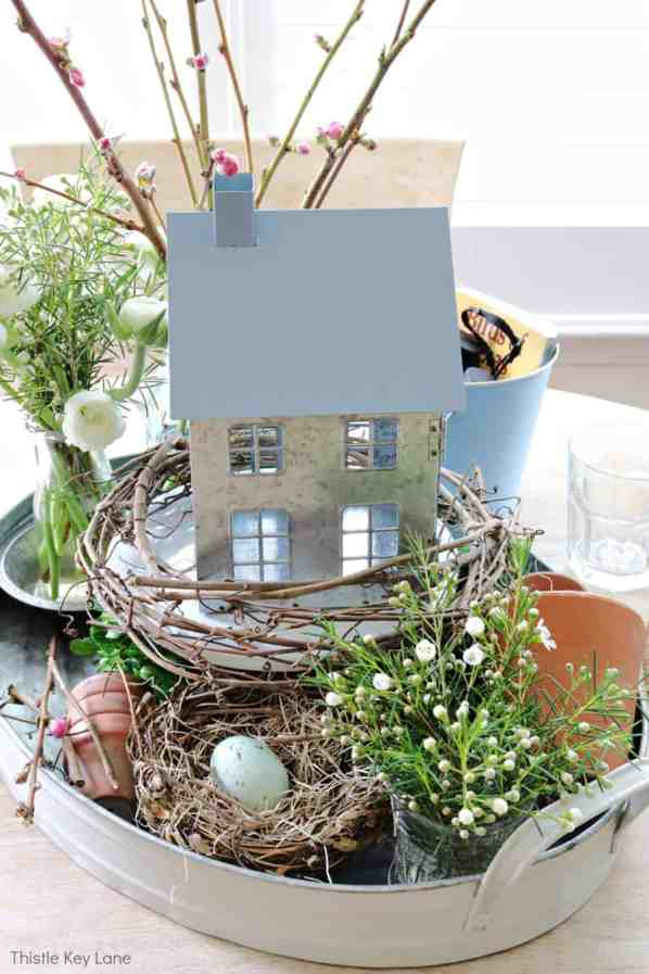 Spring vignette with bird nest, flowers and a house. Spring Bird Theme Inspired Centerpiece.