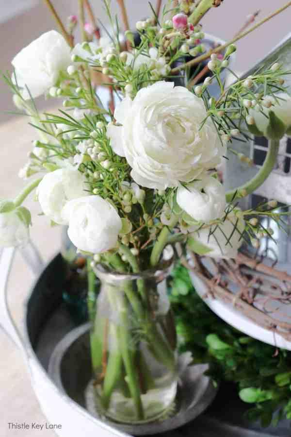 White ranunculus in a milk bottle. Spring Bird Theme Inspired Centerpiece.