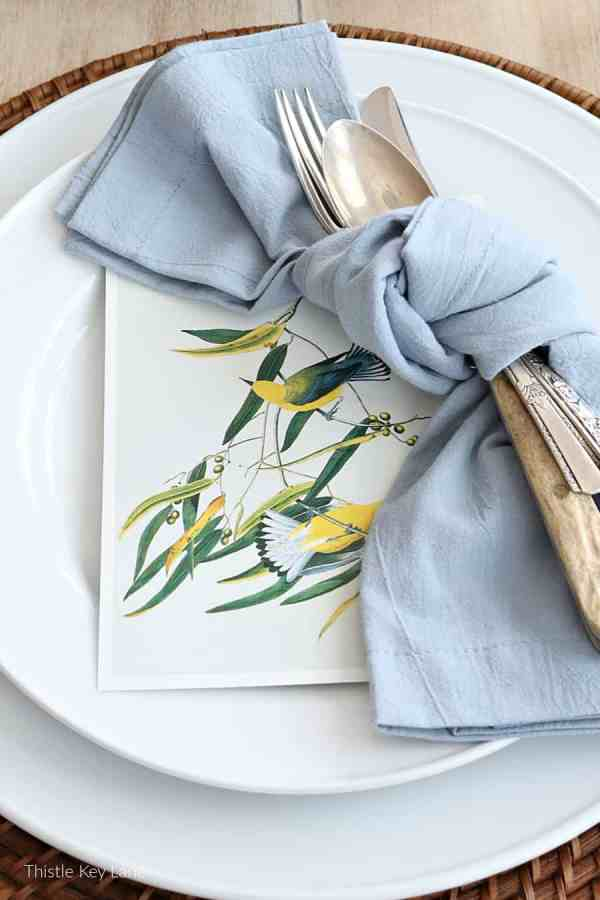 Yellow birds print on a place setting.