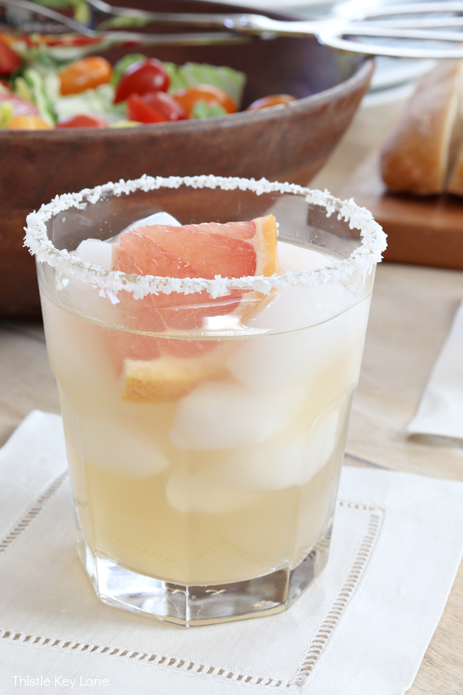 Cocktail with salt rim glass and a slice of grapefruit. Elderflower Grapefruit Margarita Cocktail Recipe.