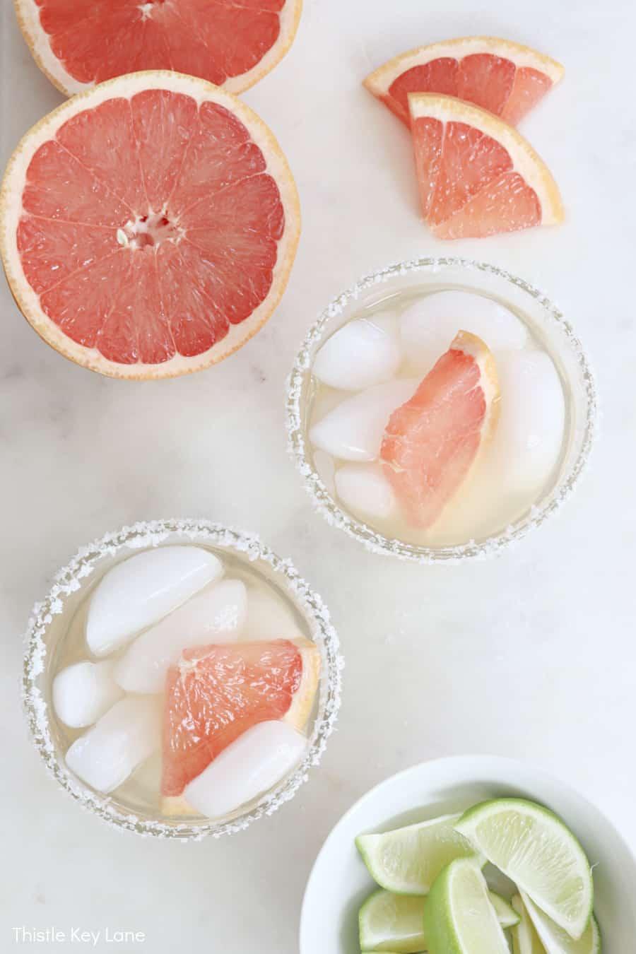 Top view of sliced grapefruit in drinks. Elderflower Grapefruit Margarita Cocktail Recipe.