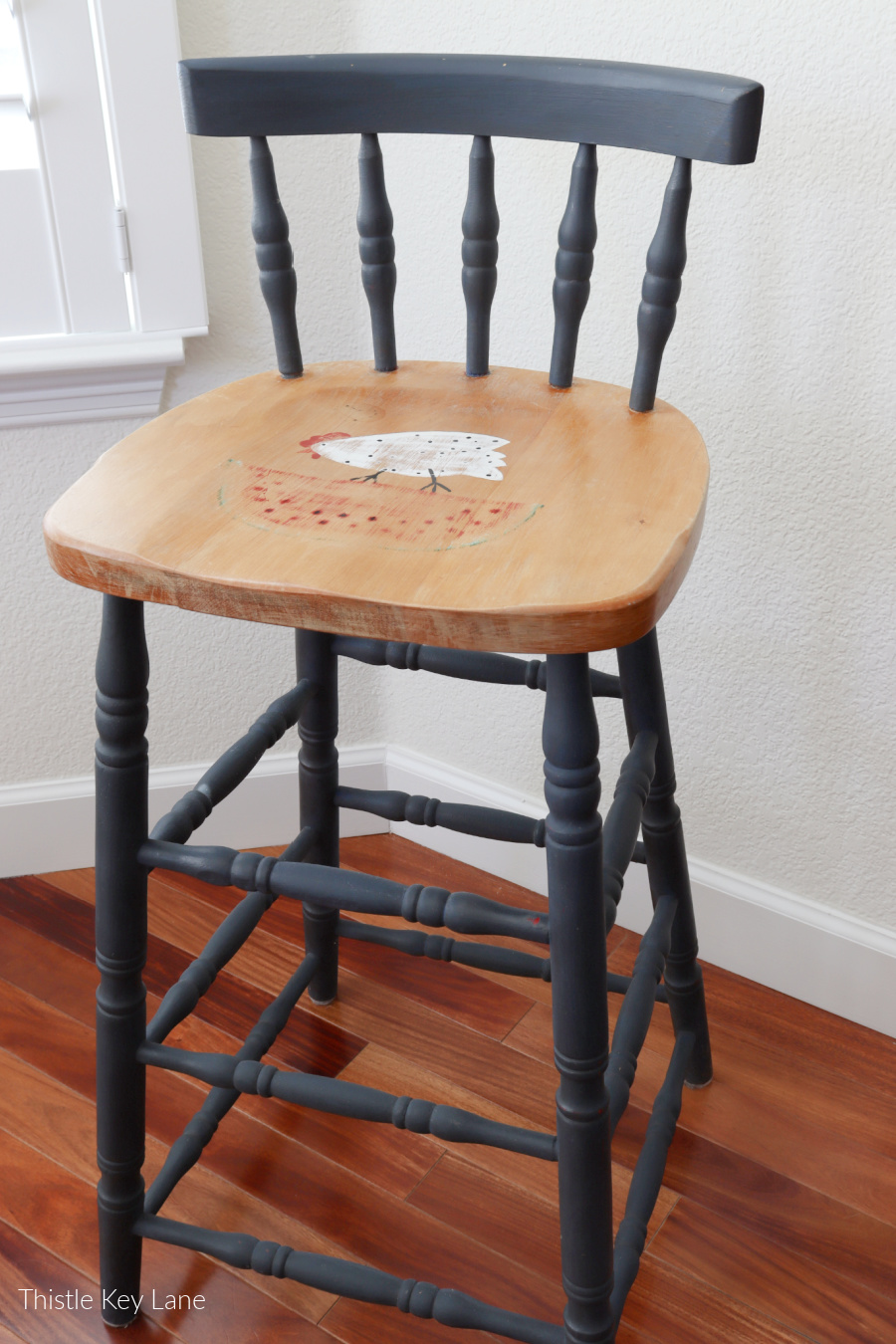 Vintage Windsor chair painted with a chicken.