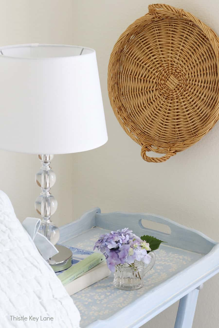 Blue painted table with hydrangea arrangement. Summer Bedroom Updates And A Quilt Basket.