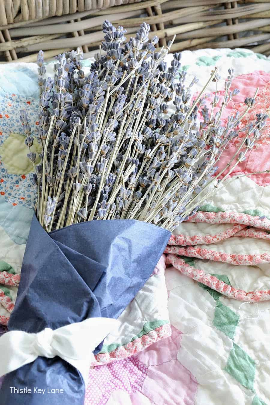 Bundle of dried lavender wrapped with blue paper. Summer Bedroom Updates And A Quilt Basket.