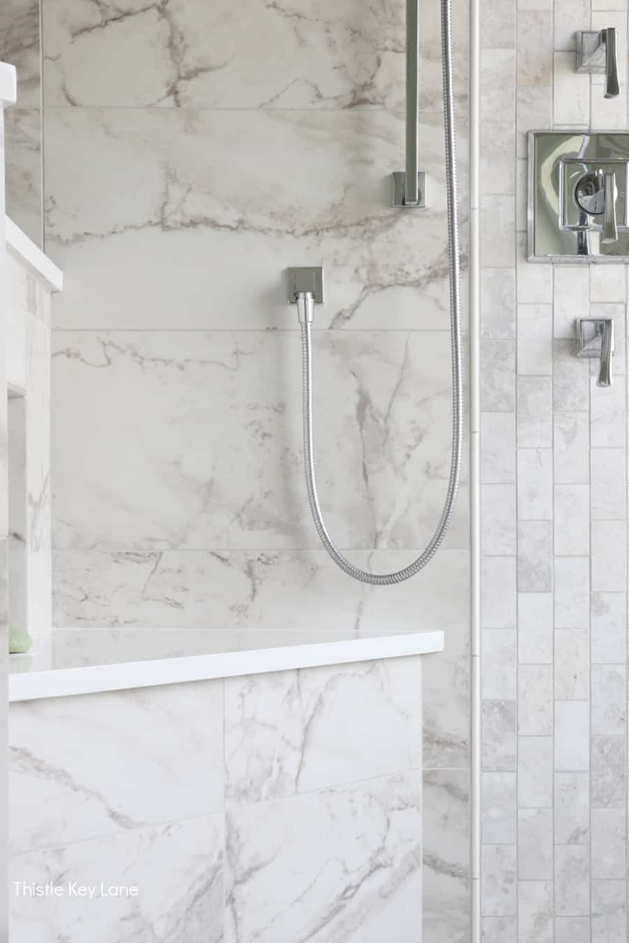 Marble and porcelain shower tile. White And Gray Bathroom Makeover.