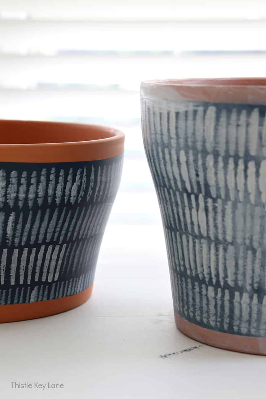 Before and after white wash over hand painted terracotta pots.