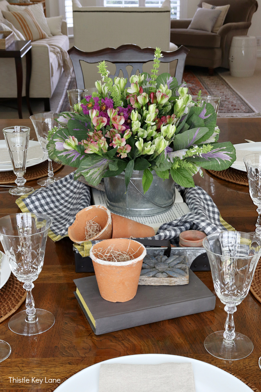 Galvanized tray and terra cotta pots in a garden centerpiece.