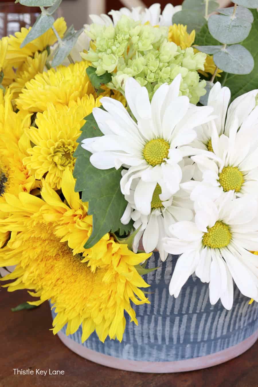 Sunflowers and mums in an arrangement. Early Fall Tablescape With Sunflowers.