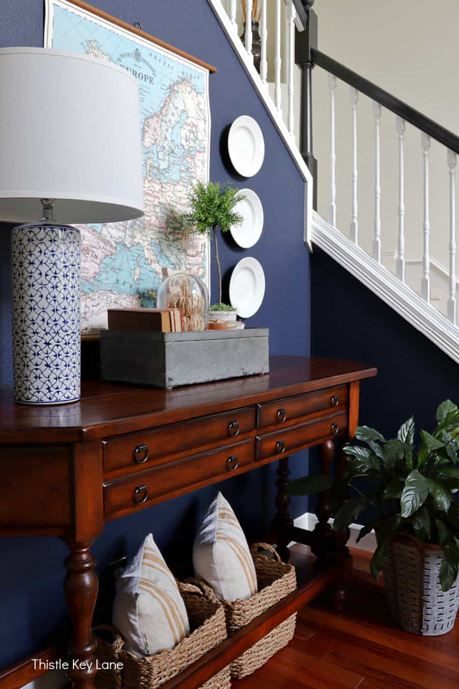 Entry table, navy wall, map, fall vignette. Fall Home Tour With Neutral Colors.
