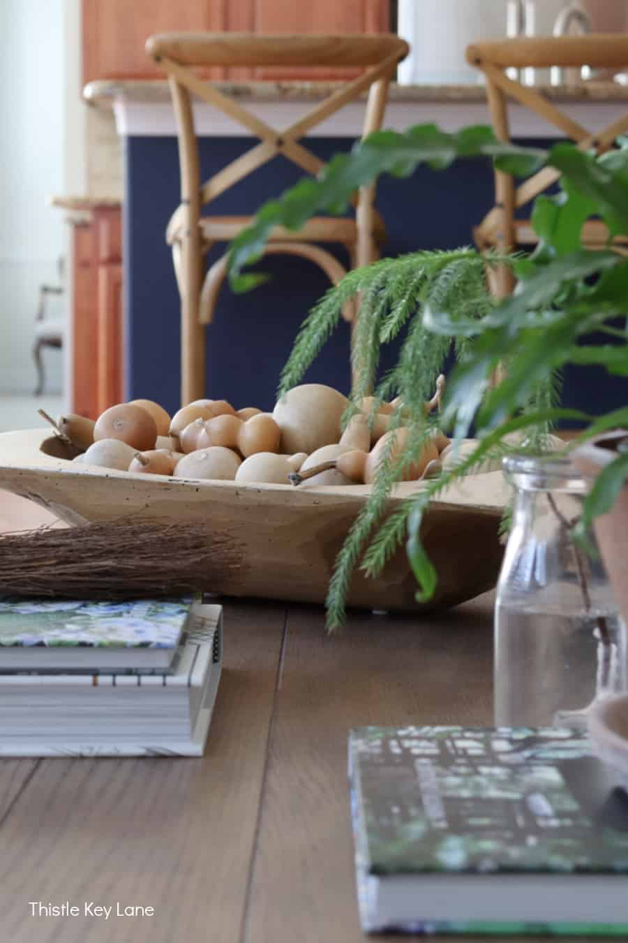 Wood dough bowl with mini gourds. Fall Home Tour With Neutral Colors.