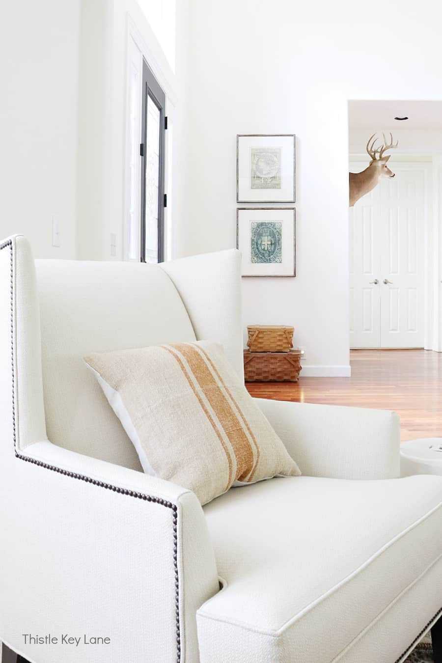 Cream wing back chair with grain sack pillow. Subtle Ways To Decorate For Fall.