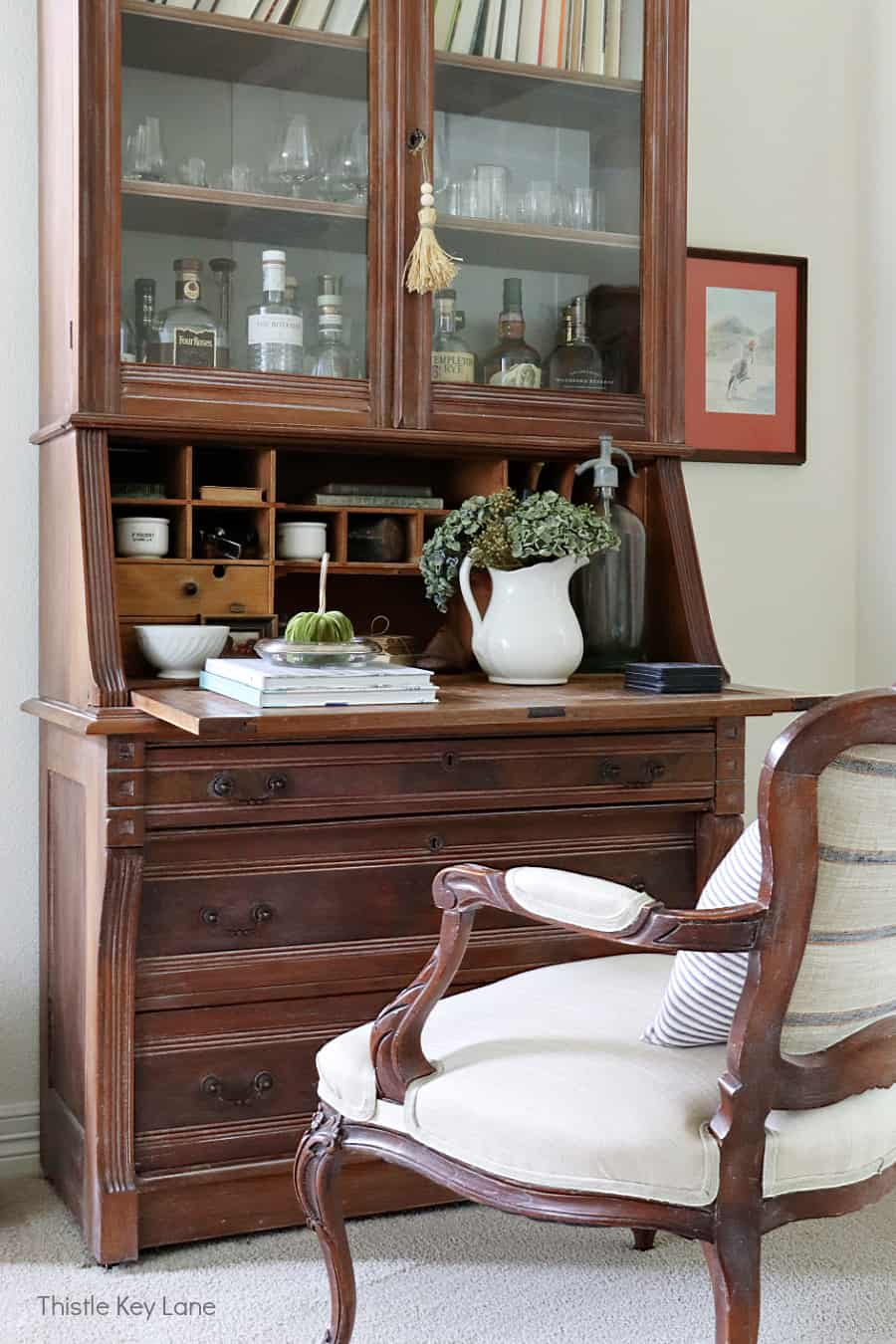 French style chair and secretary desk with glass doors.