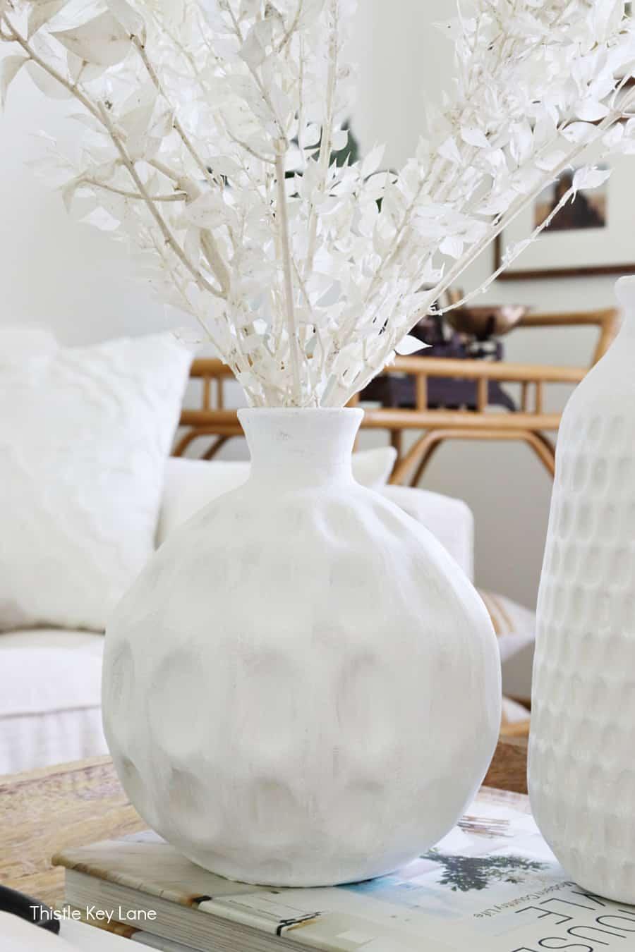 Short round vase painted white. Thrift Store Vase Makeover.