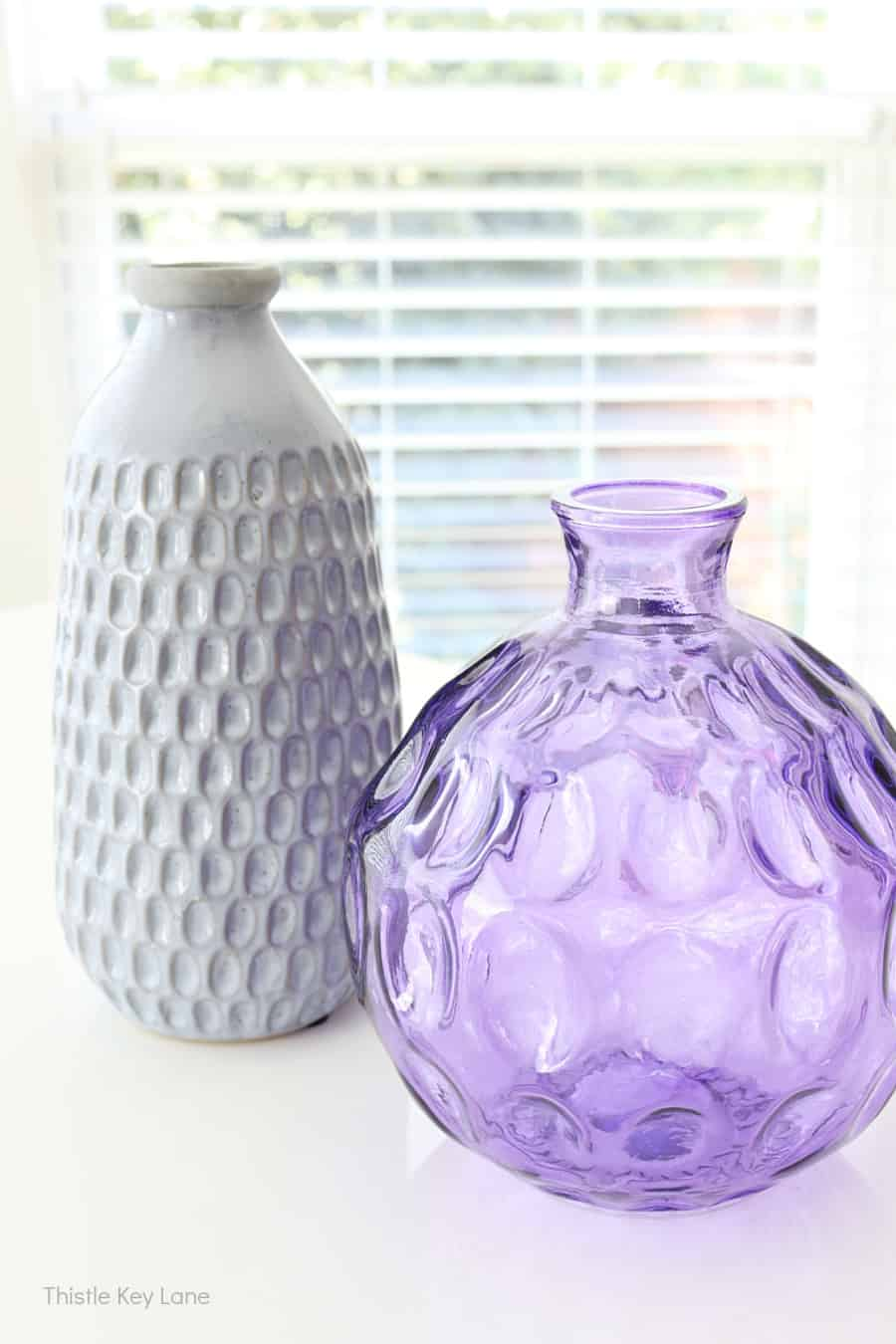 Two unmatched vases with a similar design. Thrift Store Vase Makeover.