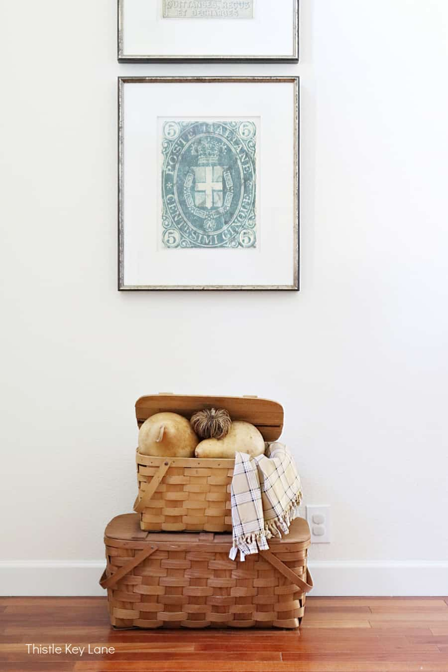 Picnic baskets stacked with fall gourds. Simple Fall Porch And Entryway Ideas.