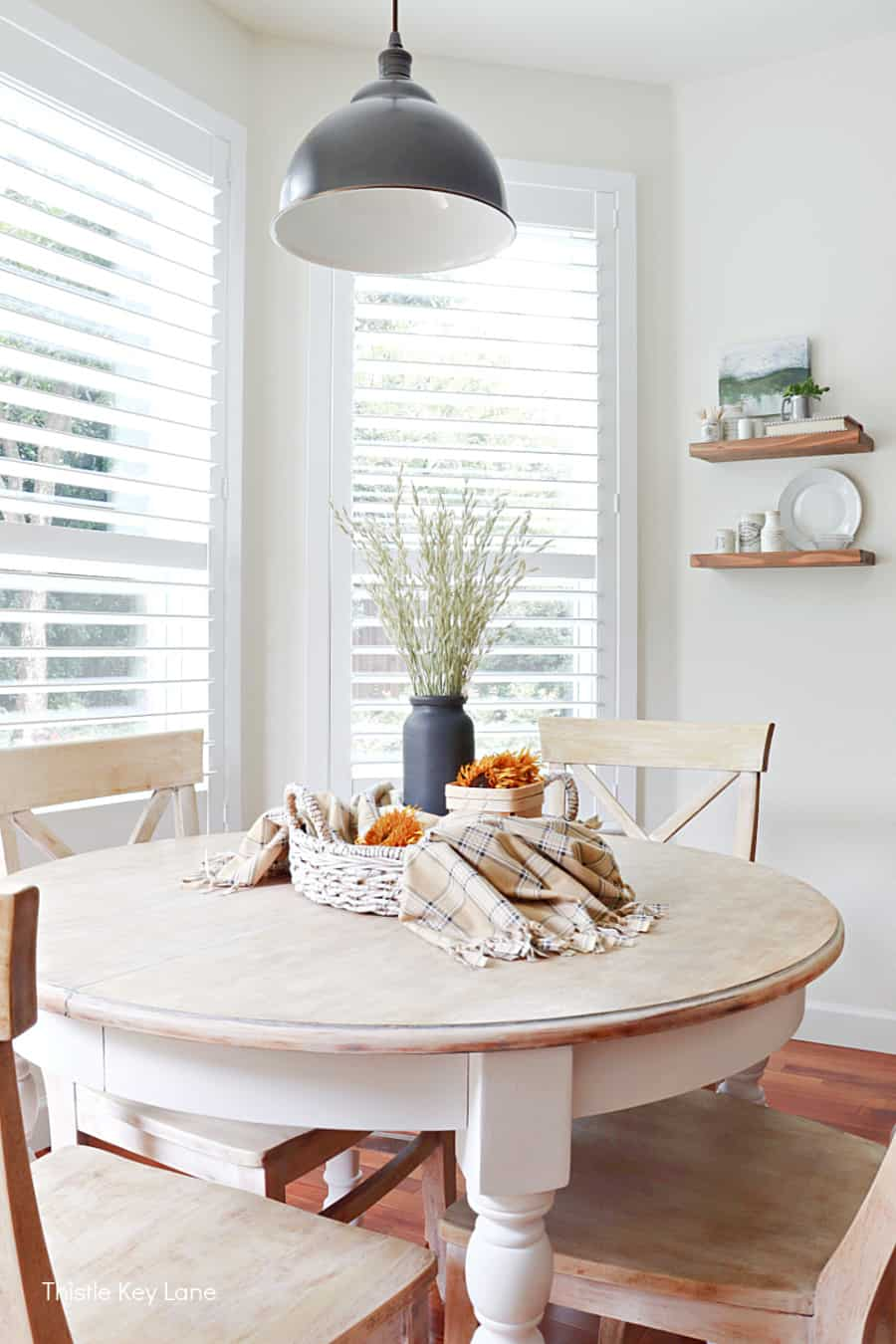 Kitchen table with fall vignette. How To Make A Plaid Table Throw.