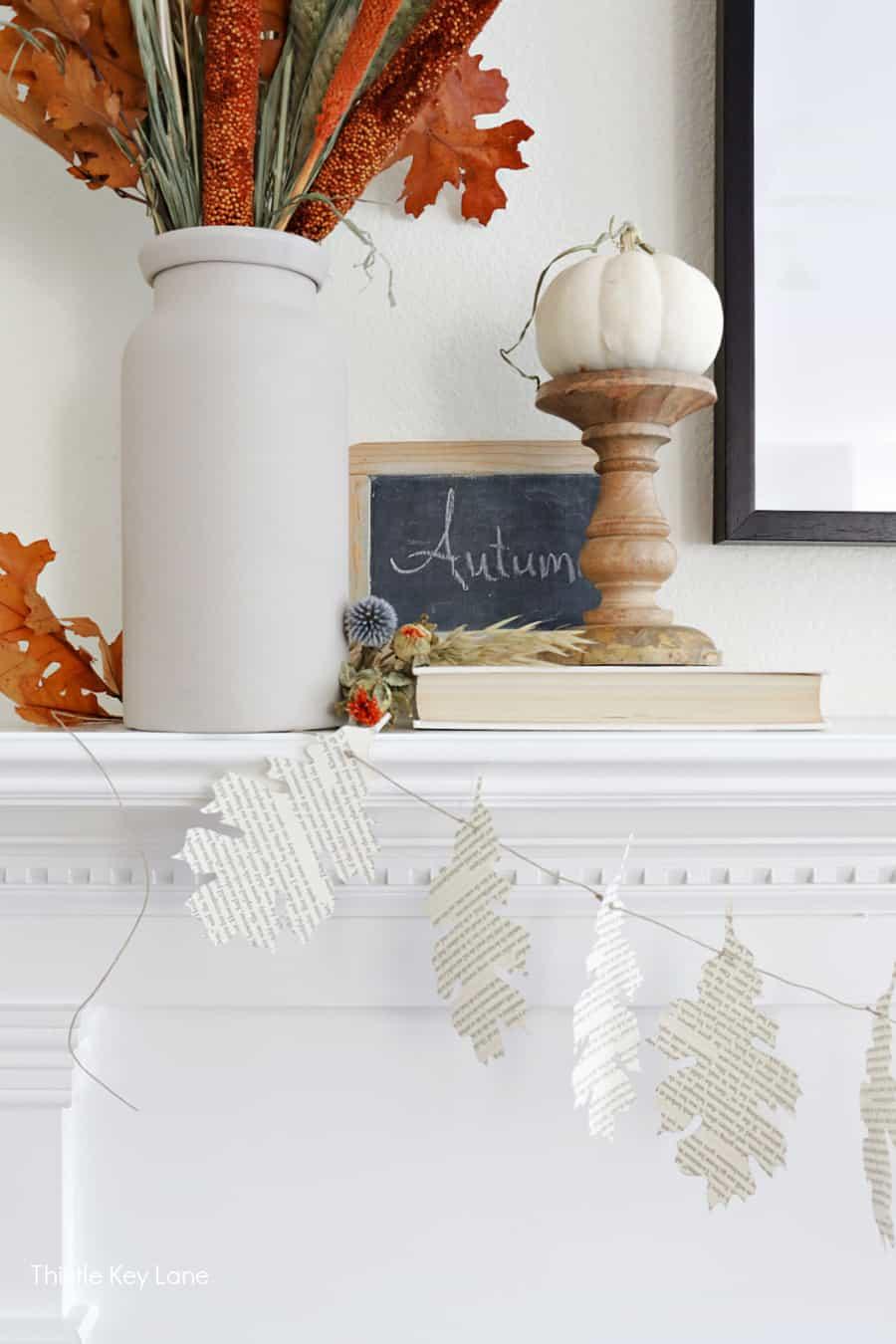 Autumn slate board, candle stick with pumpkin, leaf garland. DIY Book Page Leaf Garland.