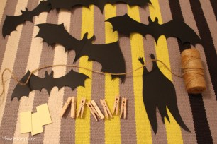 Paper bats, jute twine and clothes pins