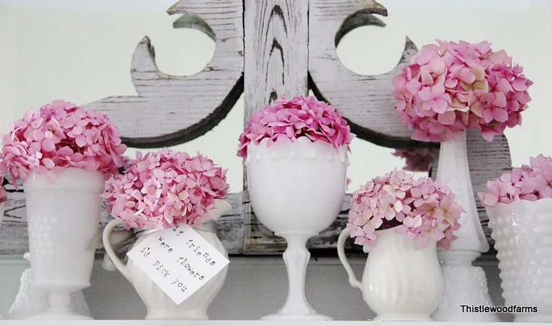 These blooming hydrangeas pop in the white crystal vases.