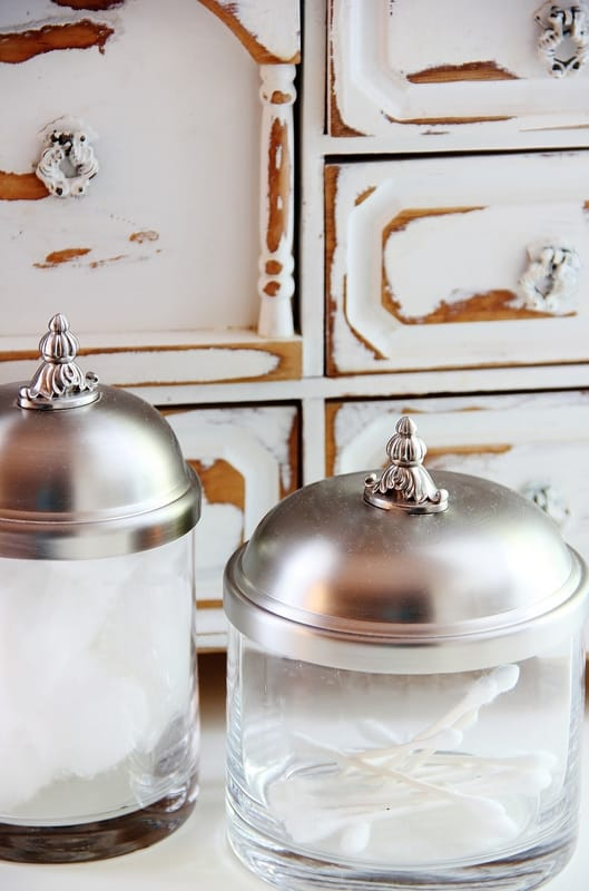 cotton balls and glass jar and wooden drawers