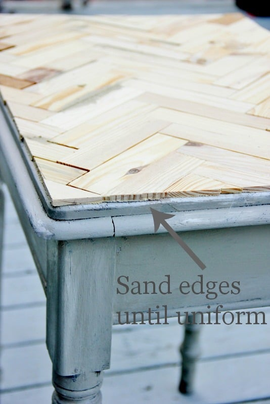 Sand all the edges of the table to make them uniform