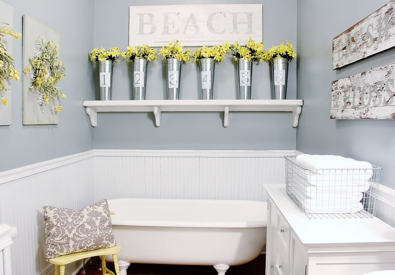 This vintage clawfoot tub and floral vases bring the farmhouse bathroom to life.