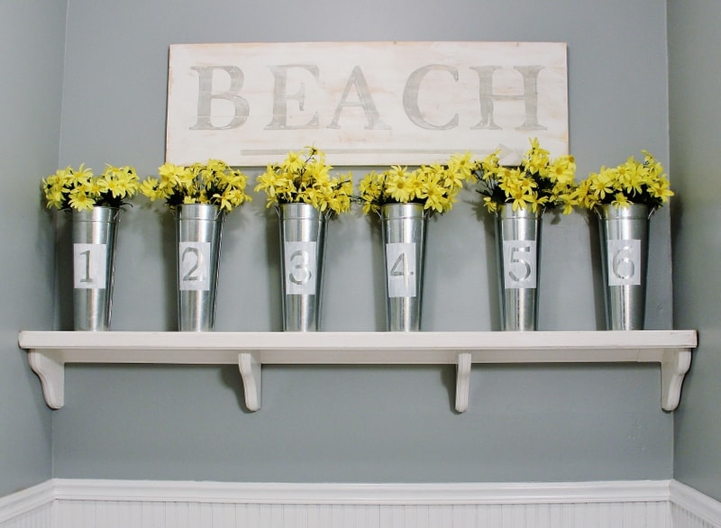 These modern silver painted vases with classic yellow dasies add to the farmhouse decor.