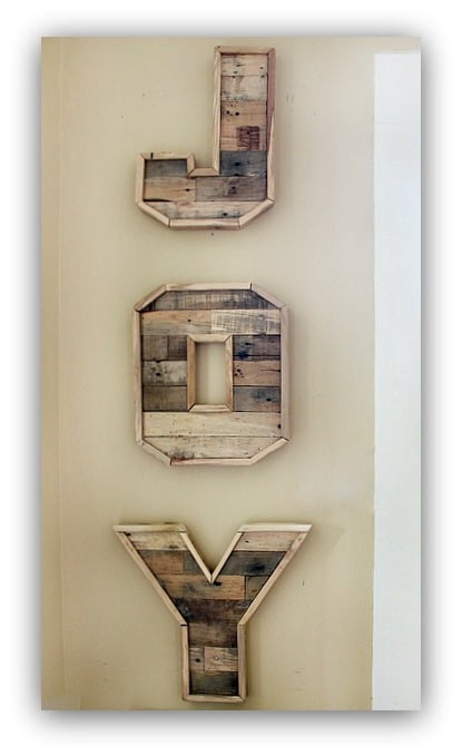 """These wall hanging letters spell """"joy"""" and are a festive touch to the home."""