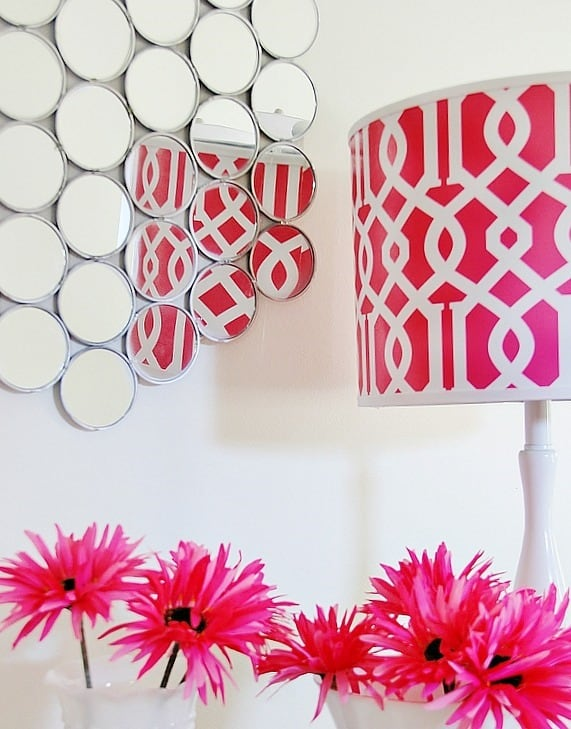 This easy to make mirror with compacts is a great accent piece.