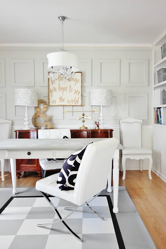 This floor cloth looks fabulous and chic in this living room