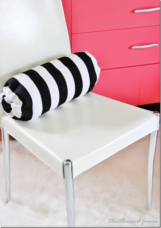 This cute bolster pillow adds a pop to almost any room.