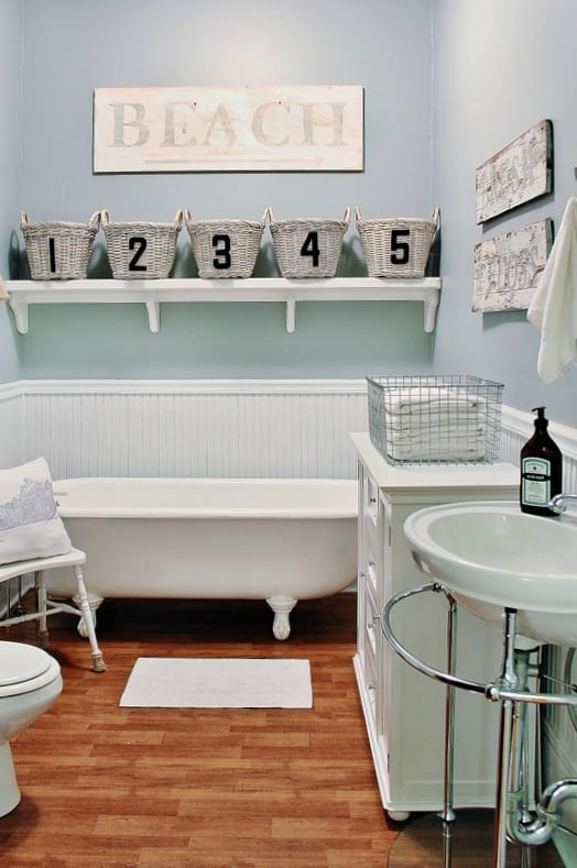 This room's wallpaper was fully removed and transformed into a cute farmhouse bathroom.