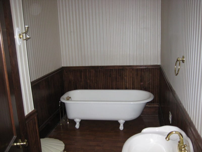 When removing wallpaper in a bathroom, finish each section and don't stop in the middle.