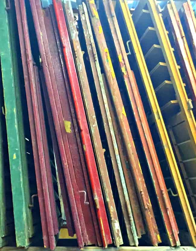 Green, purple, red, yellow, and brown painted wooden shutters from old windows