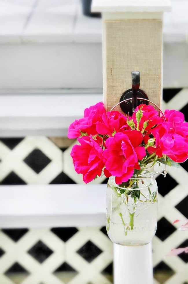 This hanging mason jar vase looks great on the house