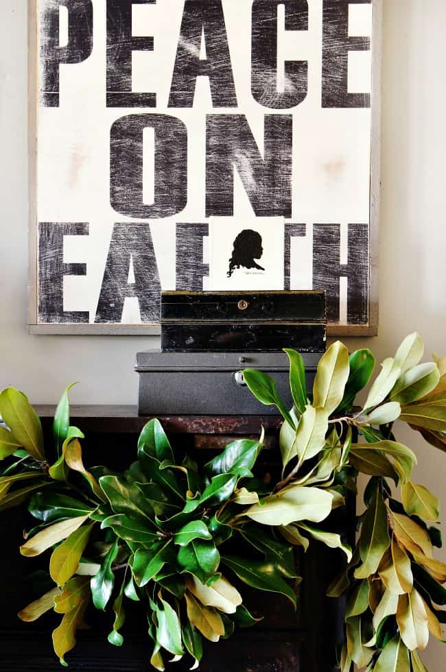 Peace on Earth sign with magnolia garland
