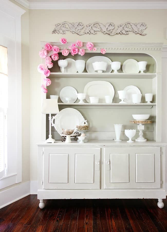 Beautiful coffee filter flowers decorating the hutch