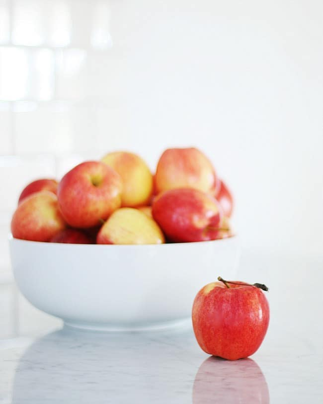 White bowl of delicious apples
