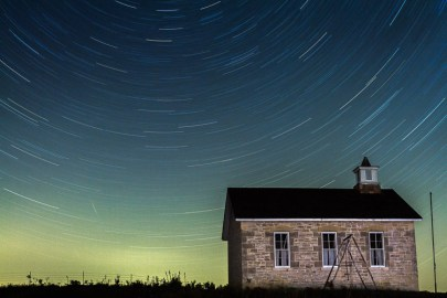 The night sky swirls above the old Lower Fox Creek schoolhouse at the Tallgrass Prairie National Preserve, Kansas. This new National Park protects almost all that is left of the tallgrass eco-system that used to stretch across the middle of North America. To learn more about this gorgeous area visit: http://www.nps.gov/tapr/index.htm This image is not a composite. I shot this using a single 40 minute exposure with a little light painting to illuminate the old schoolhouse. I then used Adobe Photoshop Lightroom 4 to enhance my original capture.