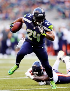 Seattle Seahawks running back Marshawn Lynch (24) runs for a touchdownduring an NFL football game against the the Chicago Bears on Saturday, August 23, 2014 in Seattle. (AP Photo/Peter Read Miller)