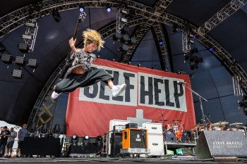 Don't just take a shot, make one. Everyone else was shooting from the right, but I wanted to get the festival logo, and position the jump between the lights. One OK Rock at Self Help Festival.