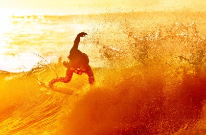 Wave Dancer. A surfer celebrates the beginning of a new day with some acrobatic moves at Rincon Point. Located near the Santa Barbara Ventura county line, Rincon is famous for its well shaped waves and long rides when conditions are just right
